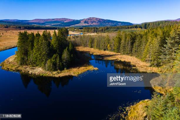 aerial view of a river running through a remote area of south west scotland - dumfries and galloway stock pictures, royalty-free photos & images