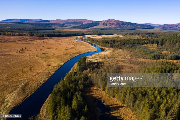 aerial view of a river running through a remote area of south west scotland - galloway scotland stock pictures, royalty-free photos & images