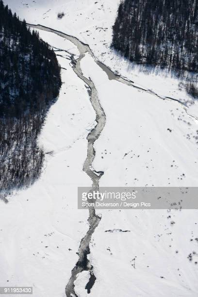 aerial view of a river running through snow in the kenai mountains in winter, kachemak bay state park - kenai mountains stock pictures, royalty-free photos & images