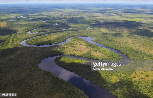 Aerial view of a river winding through the Pantanal wetlands in Mato Grosso state Brazil on March 8 2018 The Pantanal is the largest wetland on the...