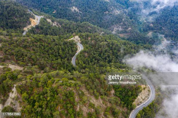 aerial view of a road winding through the troodos mountains - jeremy woodhouse stock pictures, royalty-free photos & images