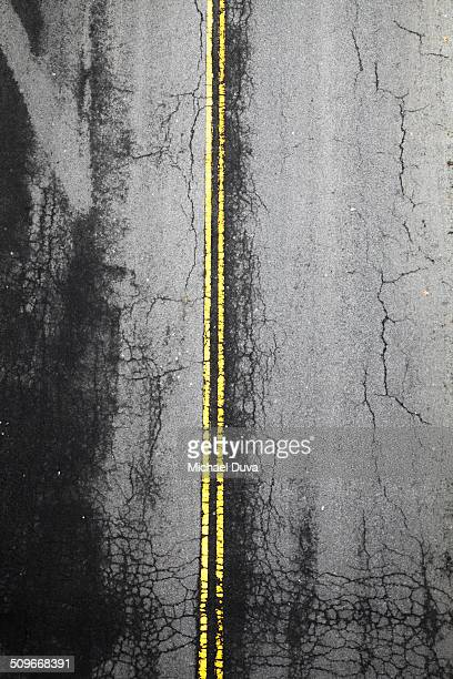 Aerial view of a road with double yellow lines