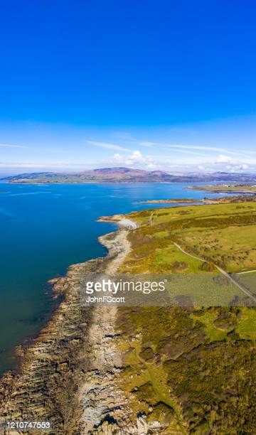 aerial view of a rocky section of coastline in south west scotland. - johnfscott stock pictures, royalty-free photos & images