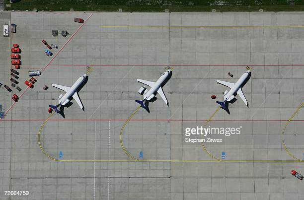 Aerial view of a row of airplanes parked
