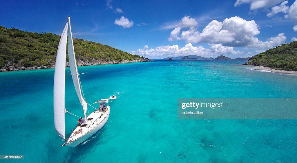 aerial view of a sailboat travelling through the Caribbean : Stock Photo