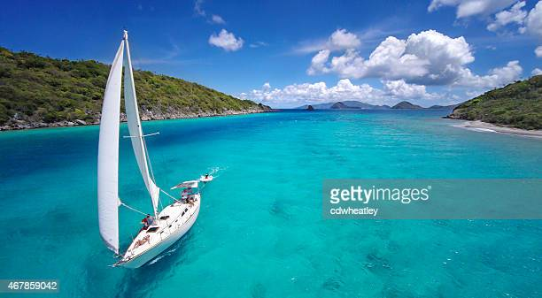aerial view of a sailboat travelling through the caribbean - yacht stock pictures, royalty-free photos & images