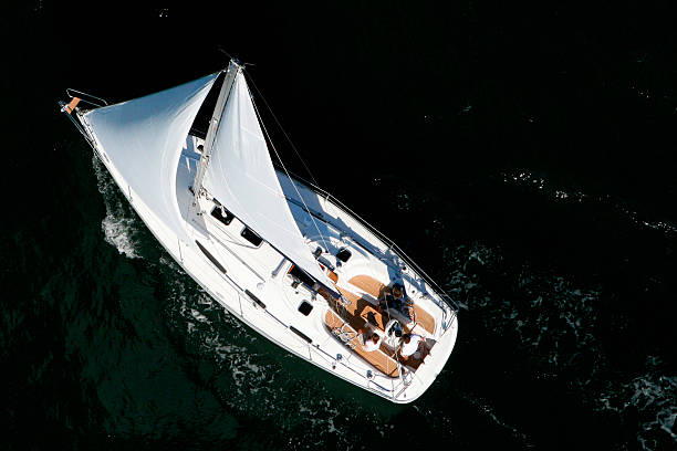 Aerial view of a sailing yacht cruising in Pittwater on the North Shore from Sydney, Australia.