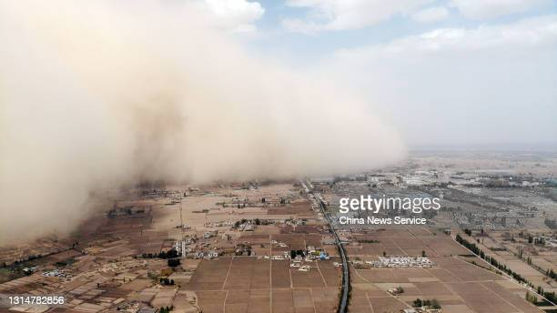 Aerial view of a sandstorm engulfing Linze county on April 25, 2021 in Zhangye, Gansu Province of China.