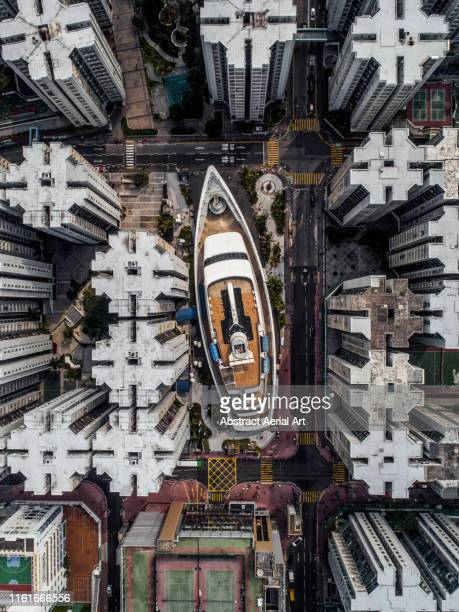 aerial view of a ship-shaped shopping centre built amongst the whampoa garden apartment complex, kowloon, hong kong - out of context stock pictures, royalty-free photos & images