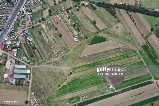 Aerial view of a sinkhole that was found by farmers in a field of crops in Santa Maria Zacatepec, state of Puebla, Mexico on June 01, 2021.