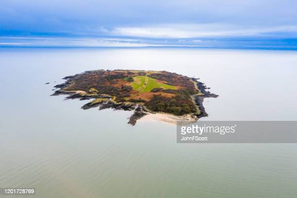 aerial view of a small island off the south west coast of scotland - johnfscott stock pictures, royalty-free photos & images