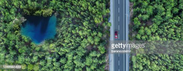 aerial view of a small pond in forest and highway - journey stock pictures, royalty-free photos & images