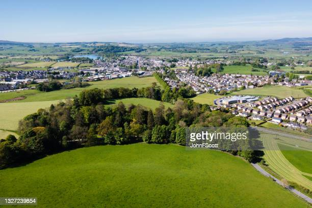 aerial view of a small rural town in scotland - johnfscott stock pictures, royalty-free photos & images