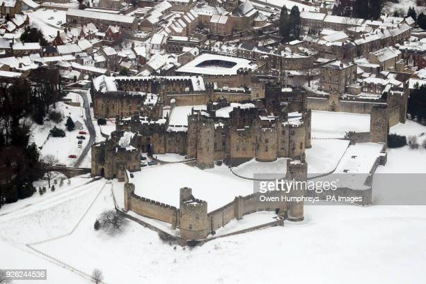 Aerial view of a snow covered Alnwick Castle as the severe weather conditions continue