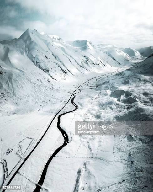 aerial view of a snowed road in westfjord - iceland - westfjords iceland stock photos and pictures