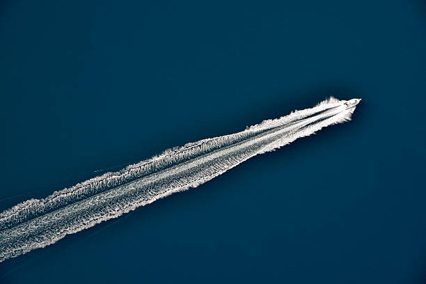 Aerial view of a speeding motorboat on sea