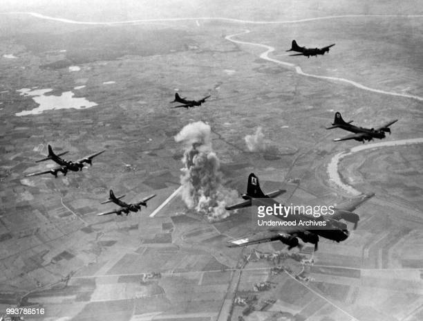 Aerial view of a squadron of American Boeing B-17 Flying Fortresses from the US 8th Air Force Bomber Command, as they fly away from a bombing run at...