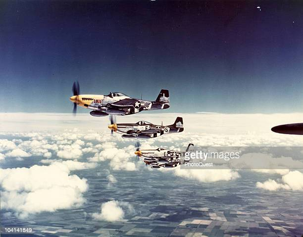 Aerial view of a squadron of North American Aviation P51 Mustang fighter planes in flight over England 1940s