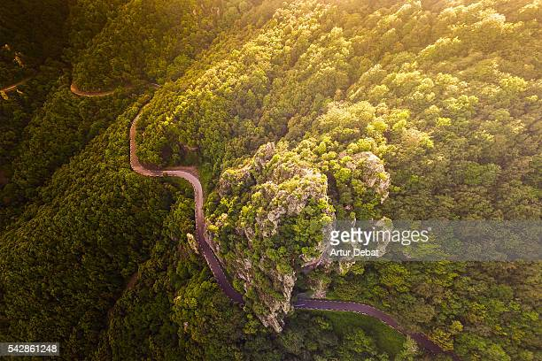 Aerial view of a stunning mountain road with wild place, tunnel, and beautiful curves with cliff in the Montseny mountain range.