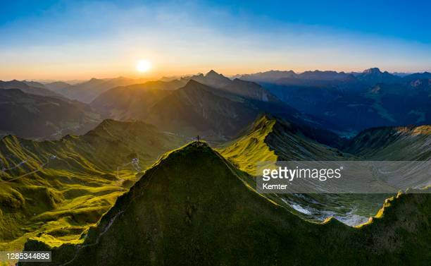 aerial view of a sunrise in the mountains - vorarlberg stock pictures, royalty-free photos & images