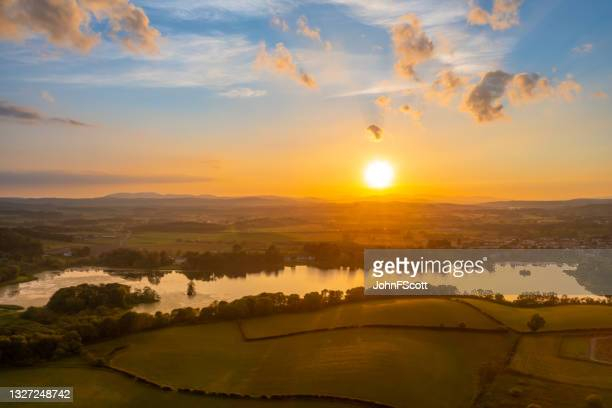 aerial view of a sunset over scottish countryside - johnfscott stock pictures, royalty-free photos & images