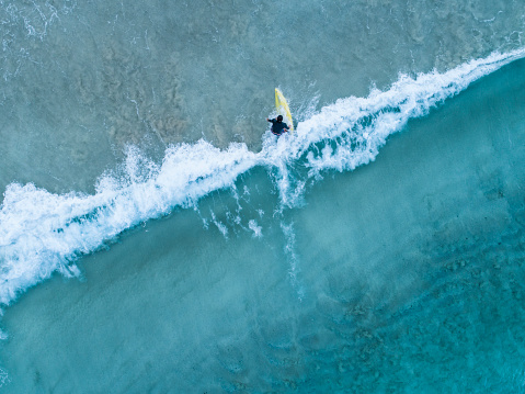 Aerial view of a surfer girl - gettyimageskorea