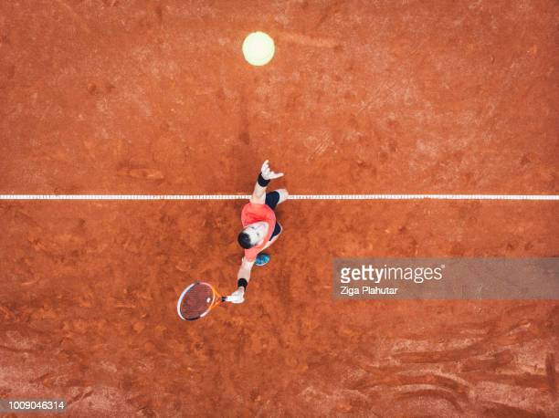 aerial view of a tennis player on the court - tennis stock pictures, royalty-free photos & images