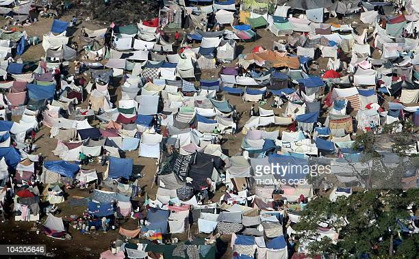 Aerial view of a tent city on on January 20 2010 outside in PortauPrince taken from a helicopter one week after a major earthquake A strong...