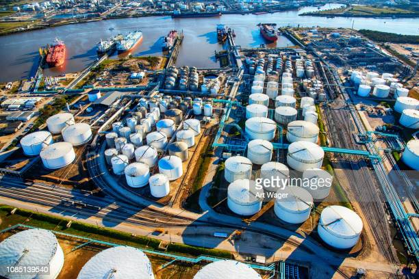 aerial view of a texas oil refinery and fuel storage tanks - oil stock pictures, royalty-free photos & images