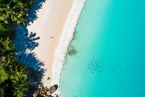 Aerial view of a tourist relaxing on a tropical beach - gettyimageskorea