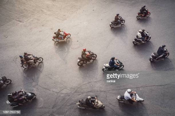 aerial view of a traffic in hanoi, vietnam - riding stock pictures, royalty-free photos & images