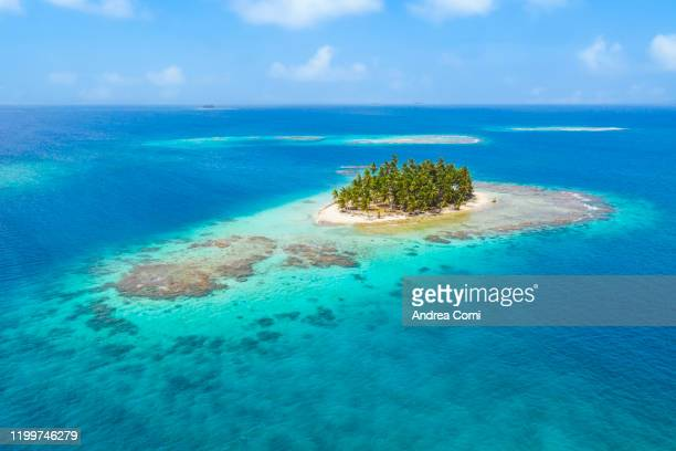 aerial view of a tropical island, san blas, panama. - island stock pictures, royalty-free photos & images
