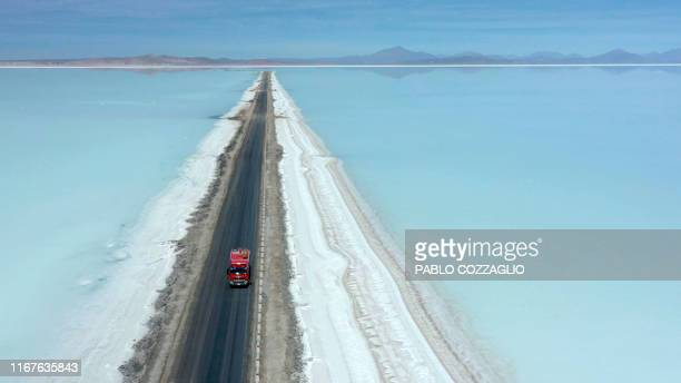Aerial view of a truck on a road crossing the flooded southern zone of the Uyuni Salt Flat, Bolivia, on July 10, 2019. - Bolivia is getting ready to...