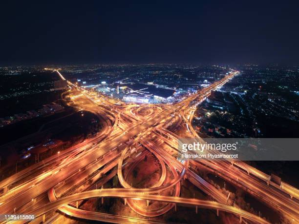 aerial view of a unique city roads and interchanges, bangkok expressway top view, top view over the highway, expressway and motorway at night aerial view from drone - top fotografías e imágenes de stock