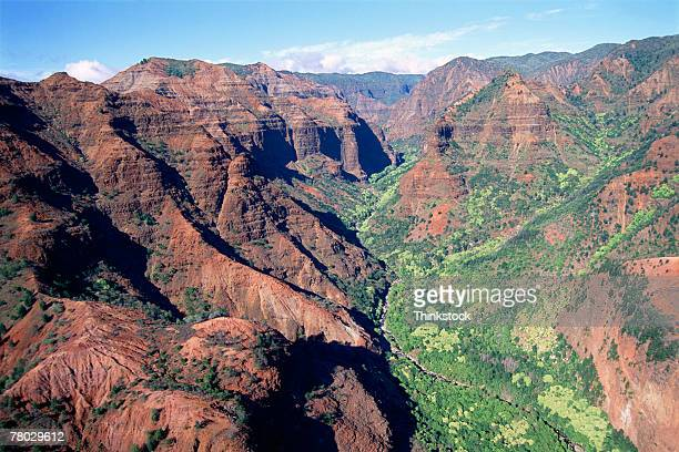 aerial view of a valley with mountains on both sides. waimea canyon, kauai, hi - waimea valley stock photos and pictures