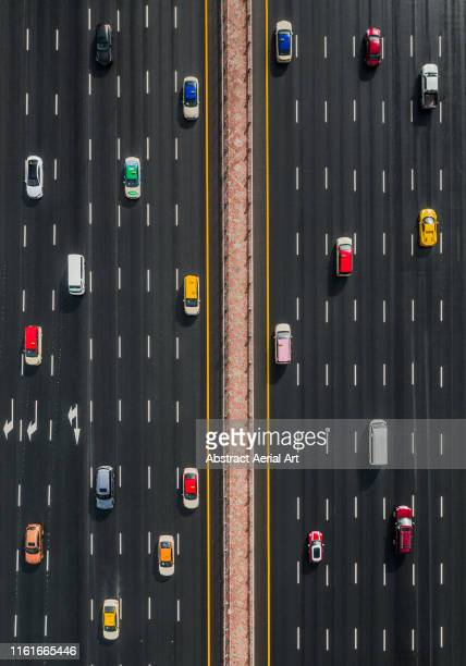 aerial view of a variety of vehicles on sheikh zayed highway, united arab emirates - images stock pictures, royalty-free photos & images