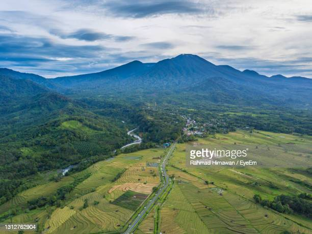 aerial view of a village in the morning with a river flowing by its side - rahmad himawan stock pictures, royalty-free photos & images