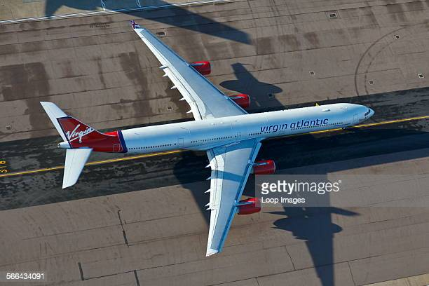 Aerial view of a Virgin Atlantic Airbus A340 taxiing at London Heathrow Airport