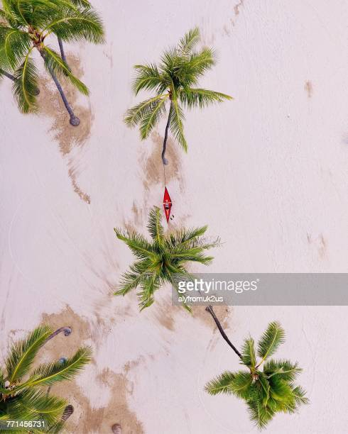 Aerial view of a woman on a hammock on the beach, Waikiki, Honolulu, Hawaii, America, USA