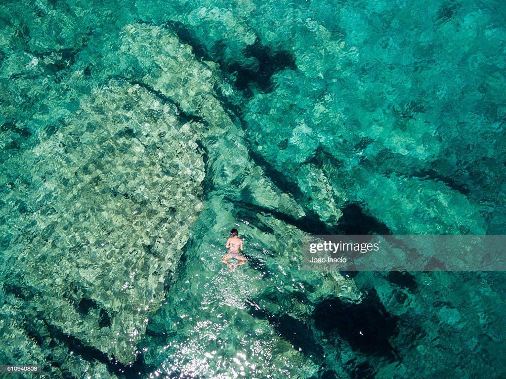 Aerial view of a young woman snorkelling - Mljet National Park, Croatia : Stock Photo