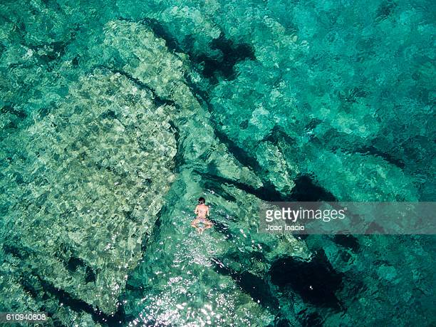 aerial view of a young woman snorkelling - mljet national park, croatia - adriatic sea stock pictures, royalty-free photos & images