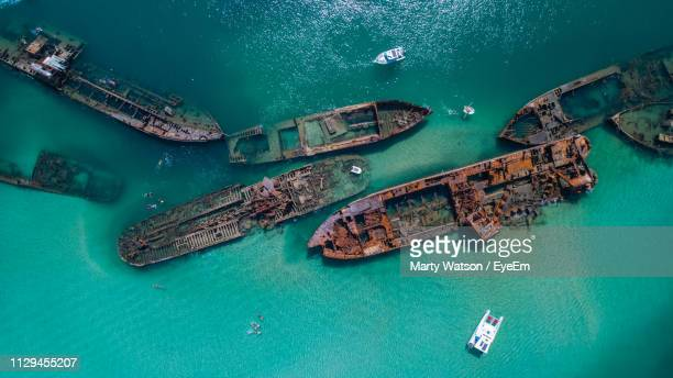 aerial view of abandoned ships in sea - ship wreck stock pictures, royalty-free photos & images
