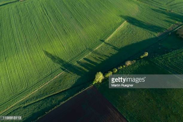 aerial view of abstract landscape with agricultural fields, trees and meadow at springtime. franconia, bavaria, germany. - beauty in nature stock pictures, royalty-free photos & images