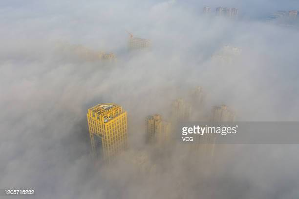 Aerial view of advection fog surrounding buildings on February 12, 2020 in Huaibei, Anhui Province of China.