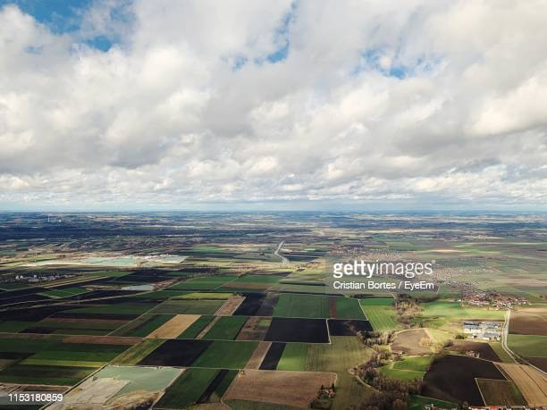 aerial view of agricultural field against sky - bortes stock photos and pictures