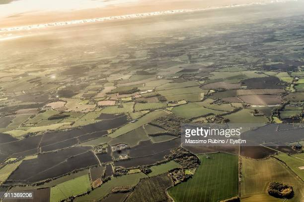 aerial view of agricultural field against sky - stansted airport stock pictures, royalty-free photos & images