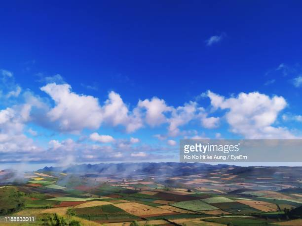 aerial view of agricultural landscape against blue sky - ko ko htike aung stock pictures, royalty-free photos & images