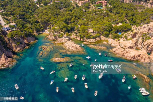 aerial view of aigua xelida beach bay with boats in begur, costa brava, spain - catalonia stock pictures, royalty-free photos & images