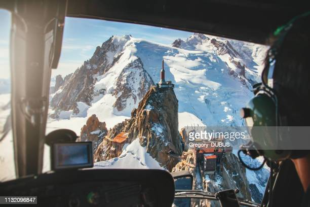 aerial view of aiguille du midi from mont blanc massif in french alps mountains view from helicopter cockpit - mont blanc massif stock photos and pictures