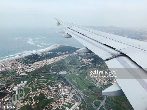 aerial view of airplane flying over landscape - bortes stock pictures, royalty-free photos & images